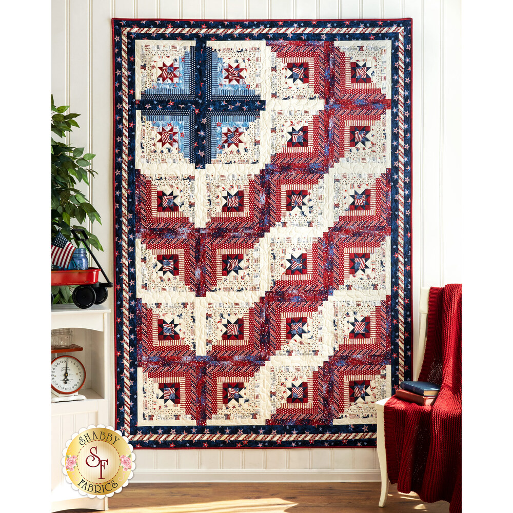The beautiful patriotic Log Cabin Americana Quilt - Liberty Lane hung on a wall