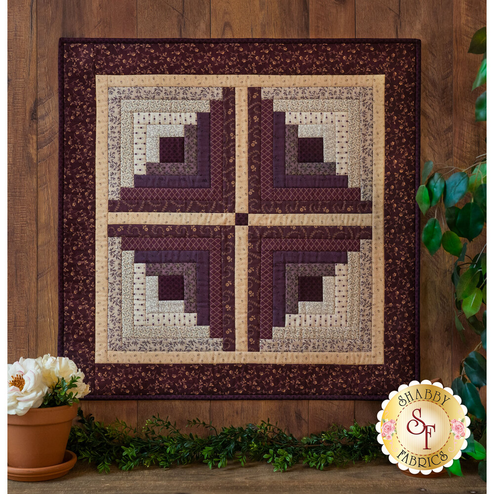 The beautiful Log Cabin Wall Hanging Kit made with the lovely Plumberry fabrics