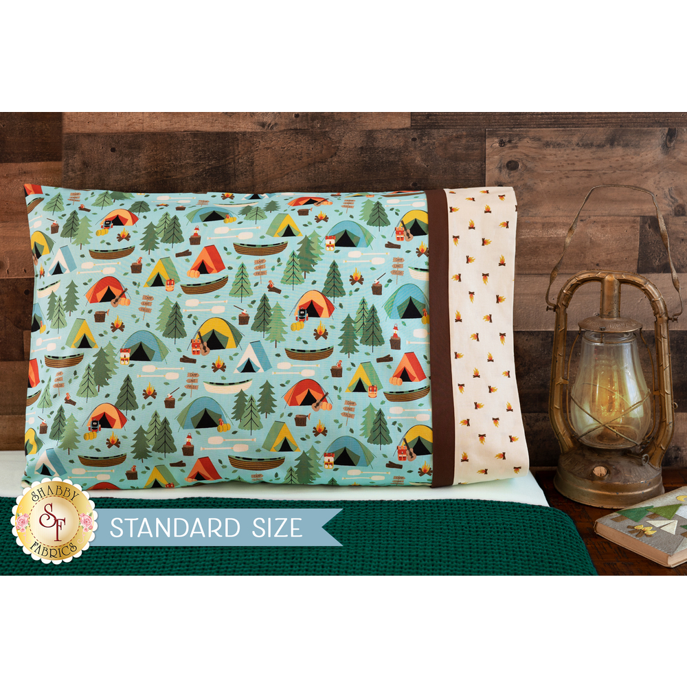 The adorable Camping Crew Magic Pillowcase - Blue displayed on a bed