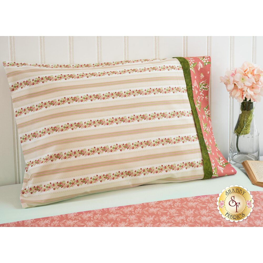 The beautiful Sensibility Magic Pillowcase displayed on a beautiful bed | Shabby Fabrics