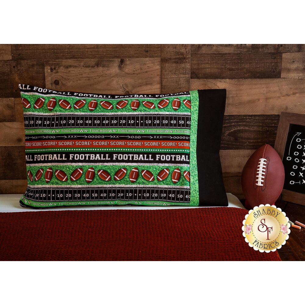 Football themed Magic Pillowcase displayed on a bed
