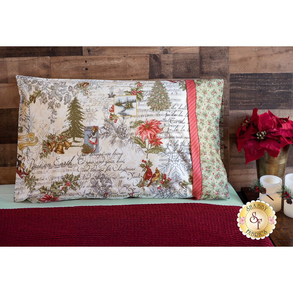 Cream and red Christmas themed pillowcase displayed on a bed