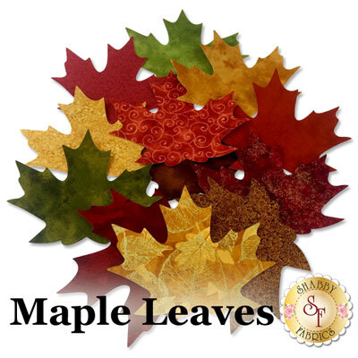 12 maple leaf applique shapes in a variety of red, green, orange, and yellow autumn prints.