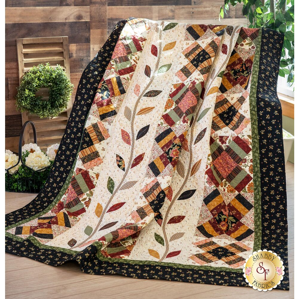 The stunning On The Road To Tarrington Quilt draped over a chair | Shabby Fabrics