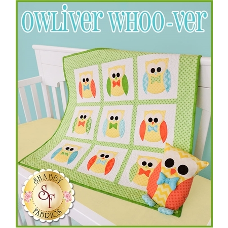 Owliver quilt with nine blocks featuring a yellow owl with a bow tie and matching pillow.