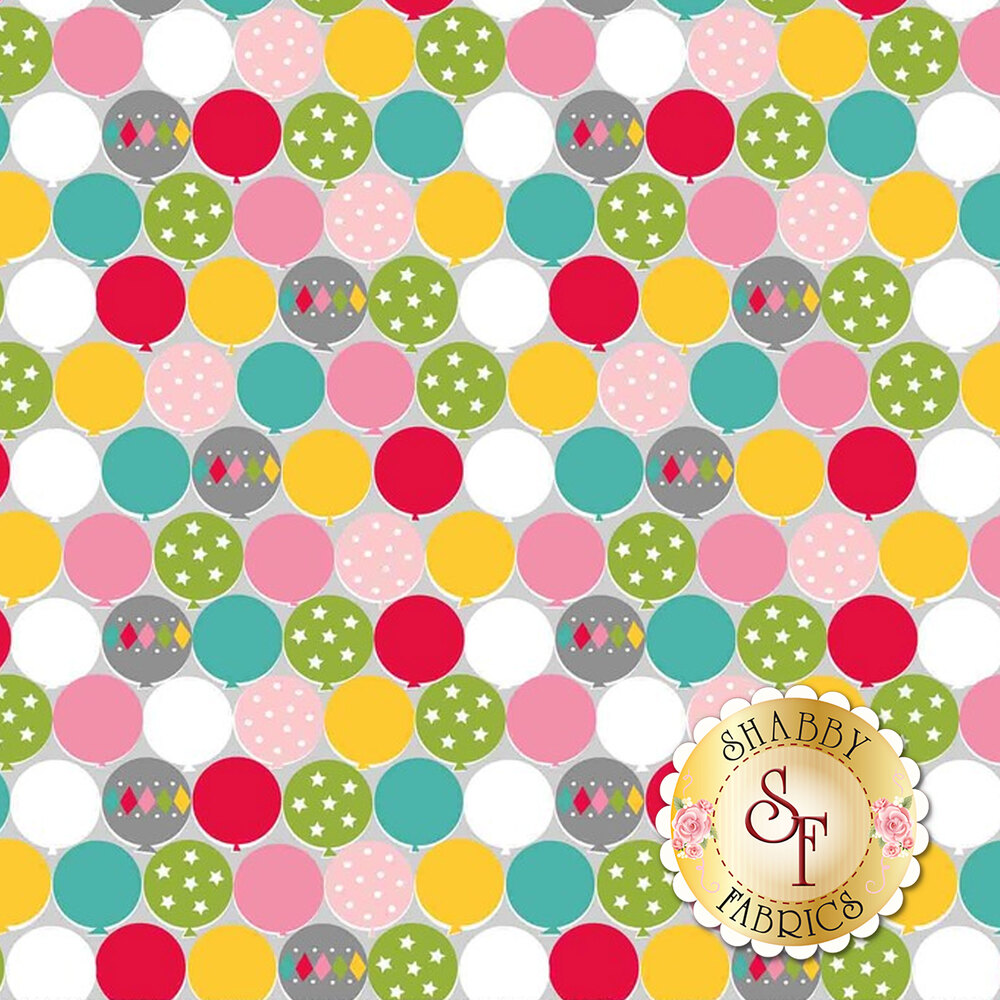 Multi-colored balloons with different designs all over a grey background | Shabby Fabrics