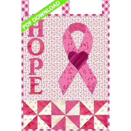 Pink applique letters reading HOPE beside a pink awareness ribbon for breast cancer.