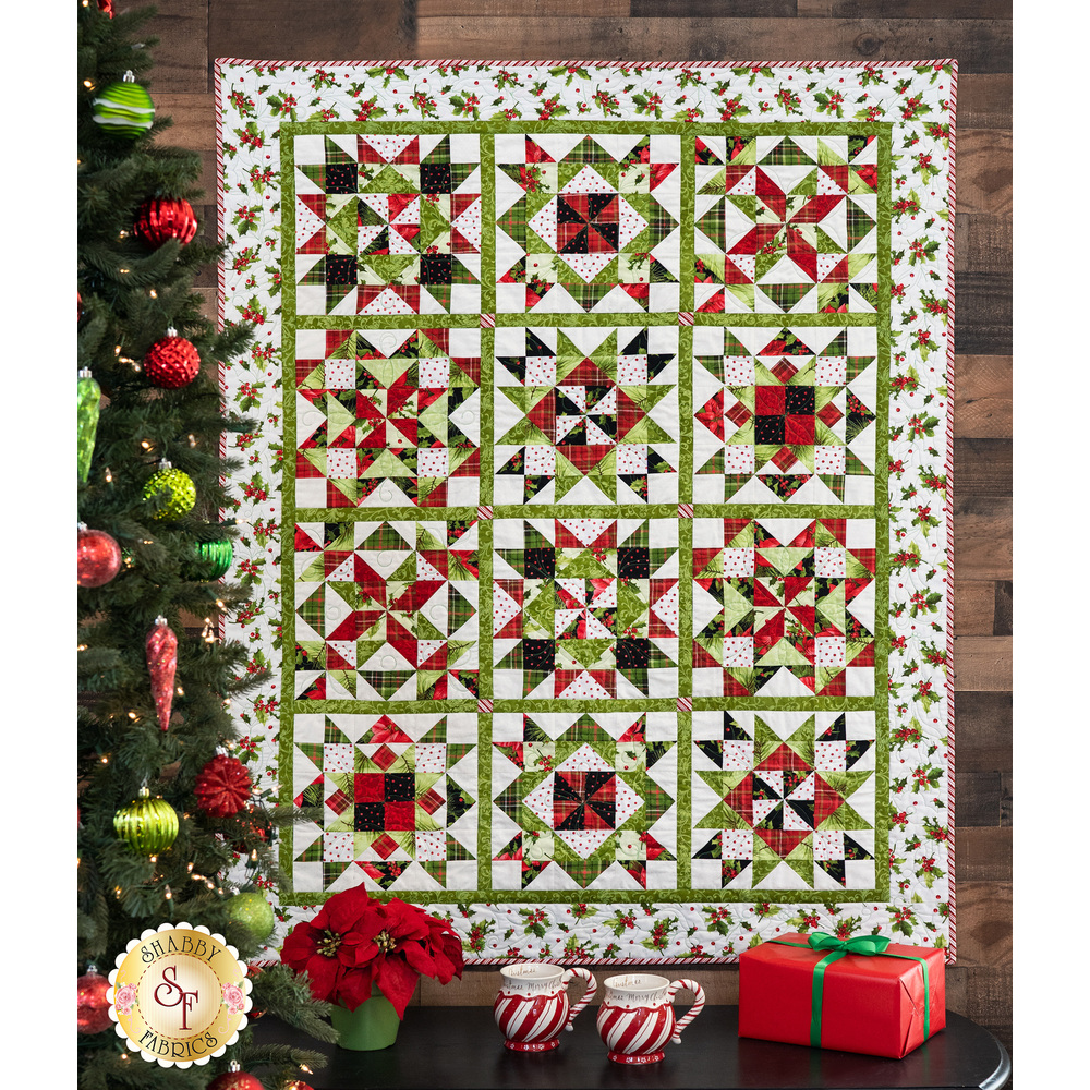 Poinsettia & Pine Patchwork Quilt displayed being a Christmas tree | Shabby Fabrics
