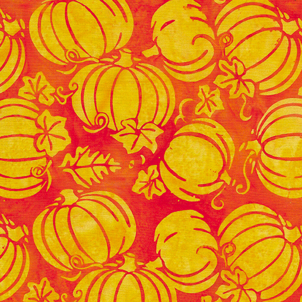 Tossed yellow pumpkins on an orange background