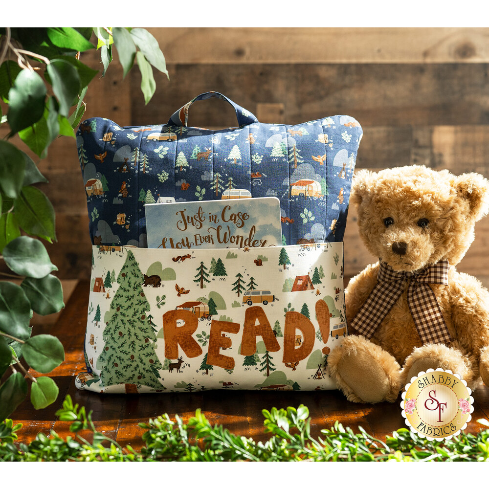 Adorable Camp Woodland Reading Pillow next to a teddy bear