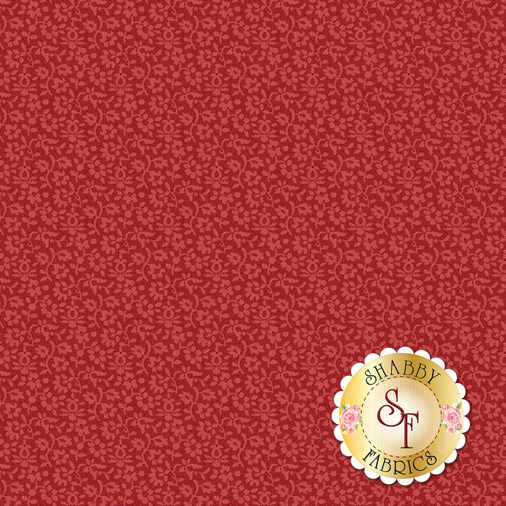 A tonal red fabric with flowers on a red background   Shabby Fabrics