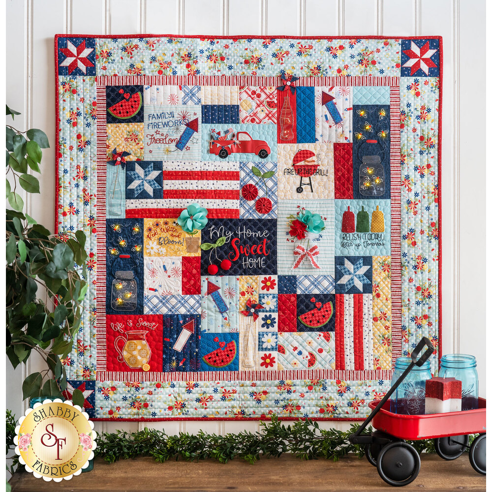 The beautiful Red, White & Bloom Quilt - Sewing Version hung from a wall