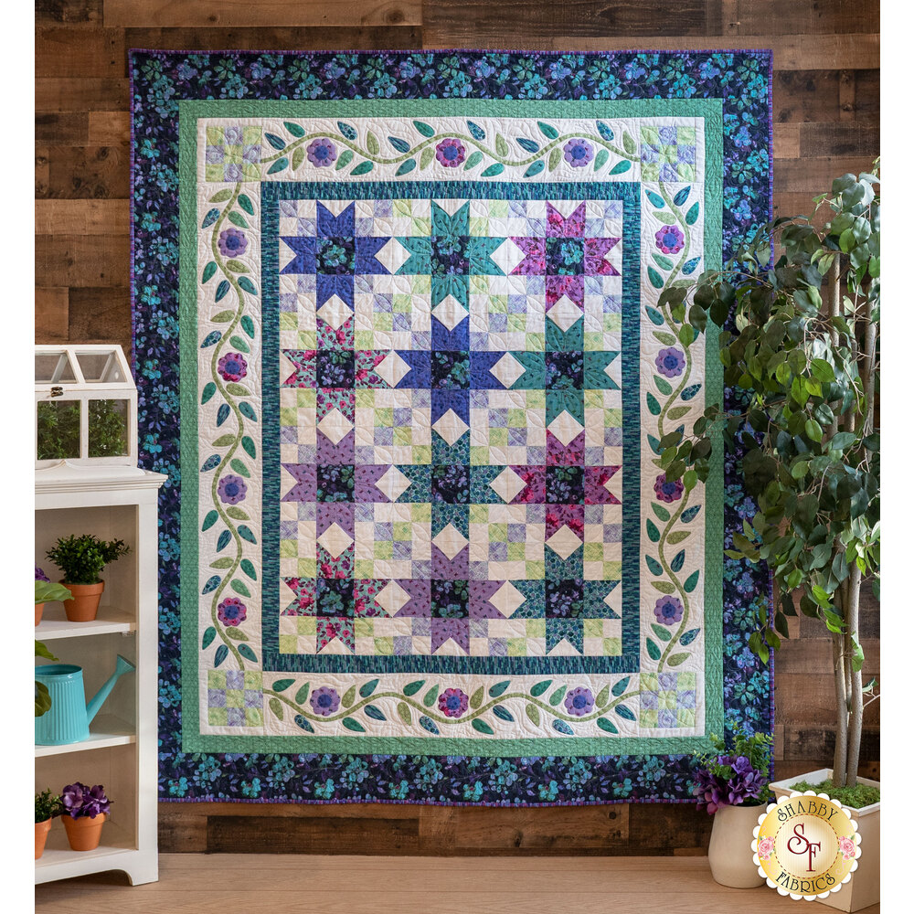 The beautiful Riviera Rose Quilt displayed on a wall | Shabby Fabrics