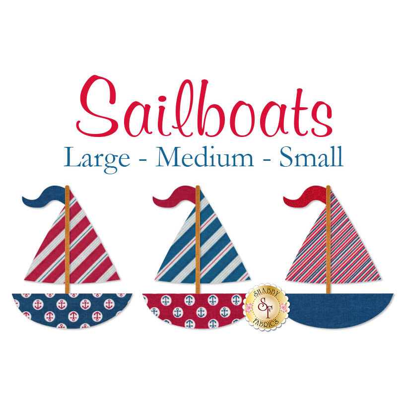 3 red and navy sailboat applique shapes cut from nautical print fabric.