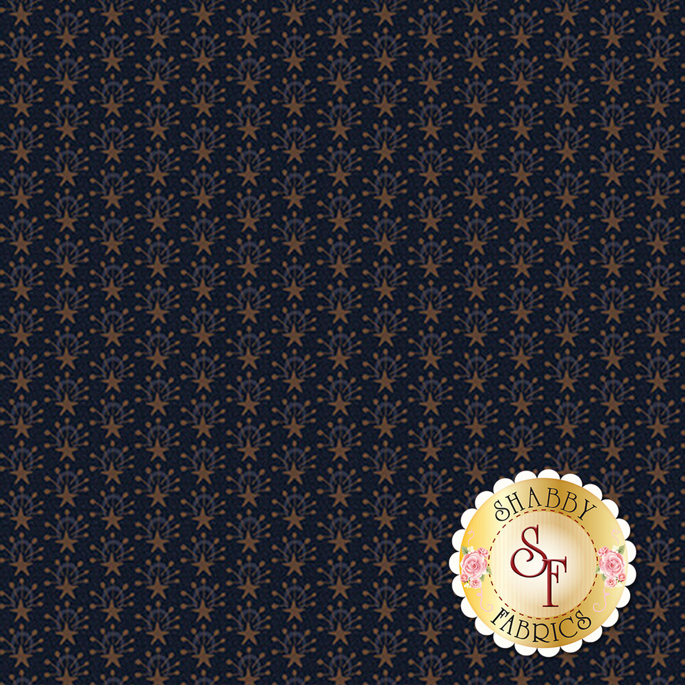 Brown star bursts all over a blue background | Shabby Fabrics