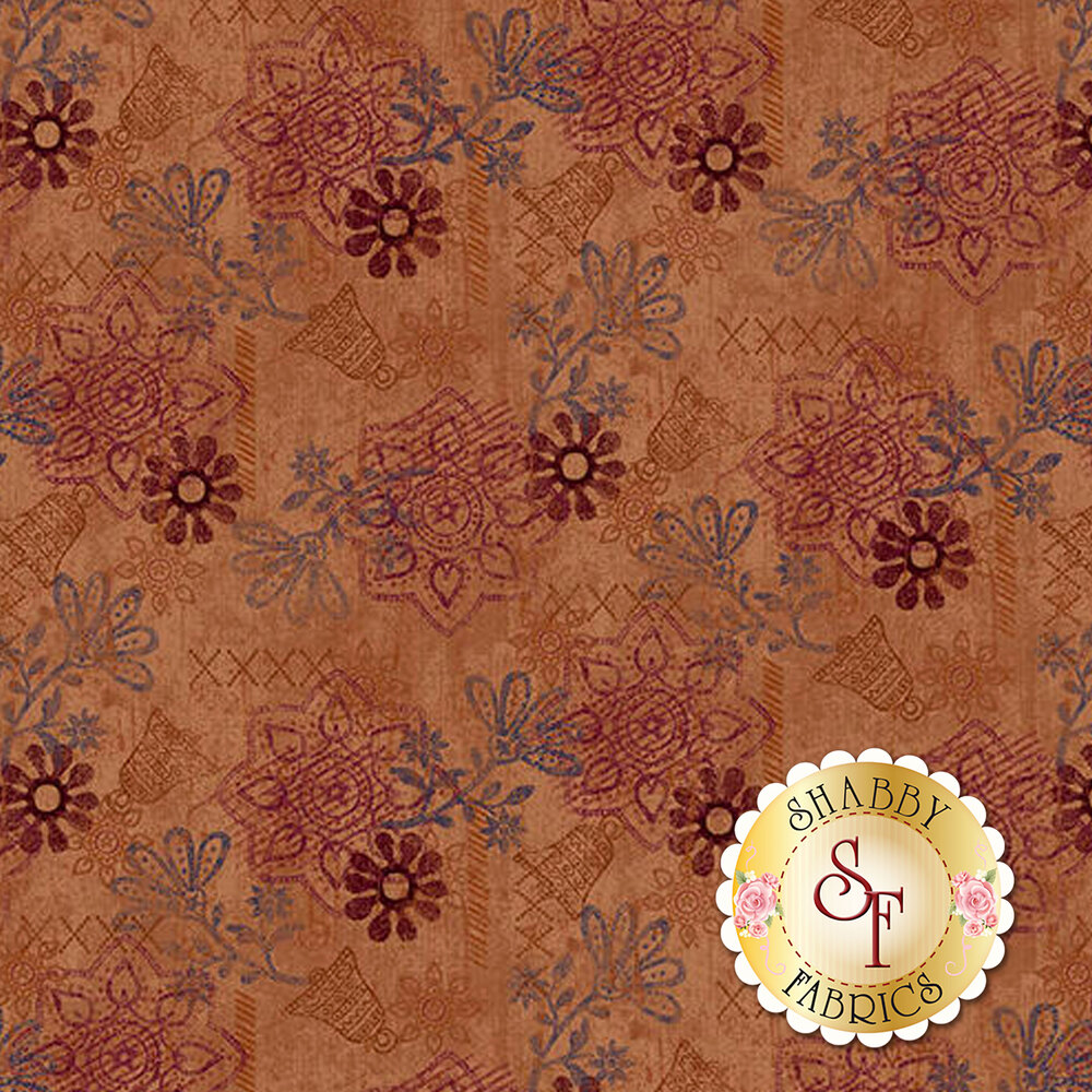 Bells, texture, and medallions all over a rust colored background | Shabby Fabrics