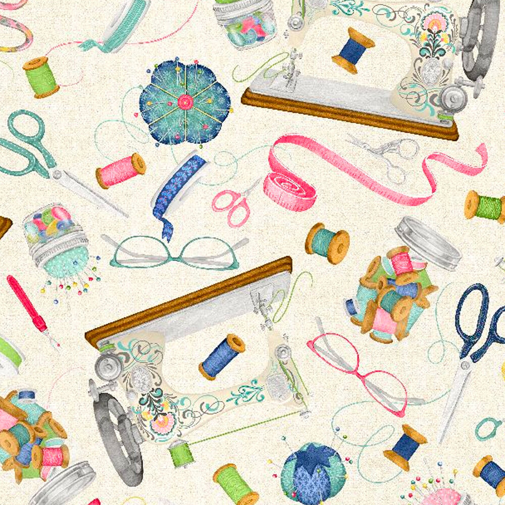 Sewing supplies tossed all over a cream background