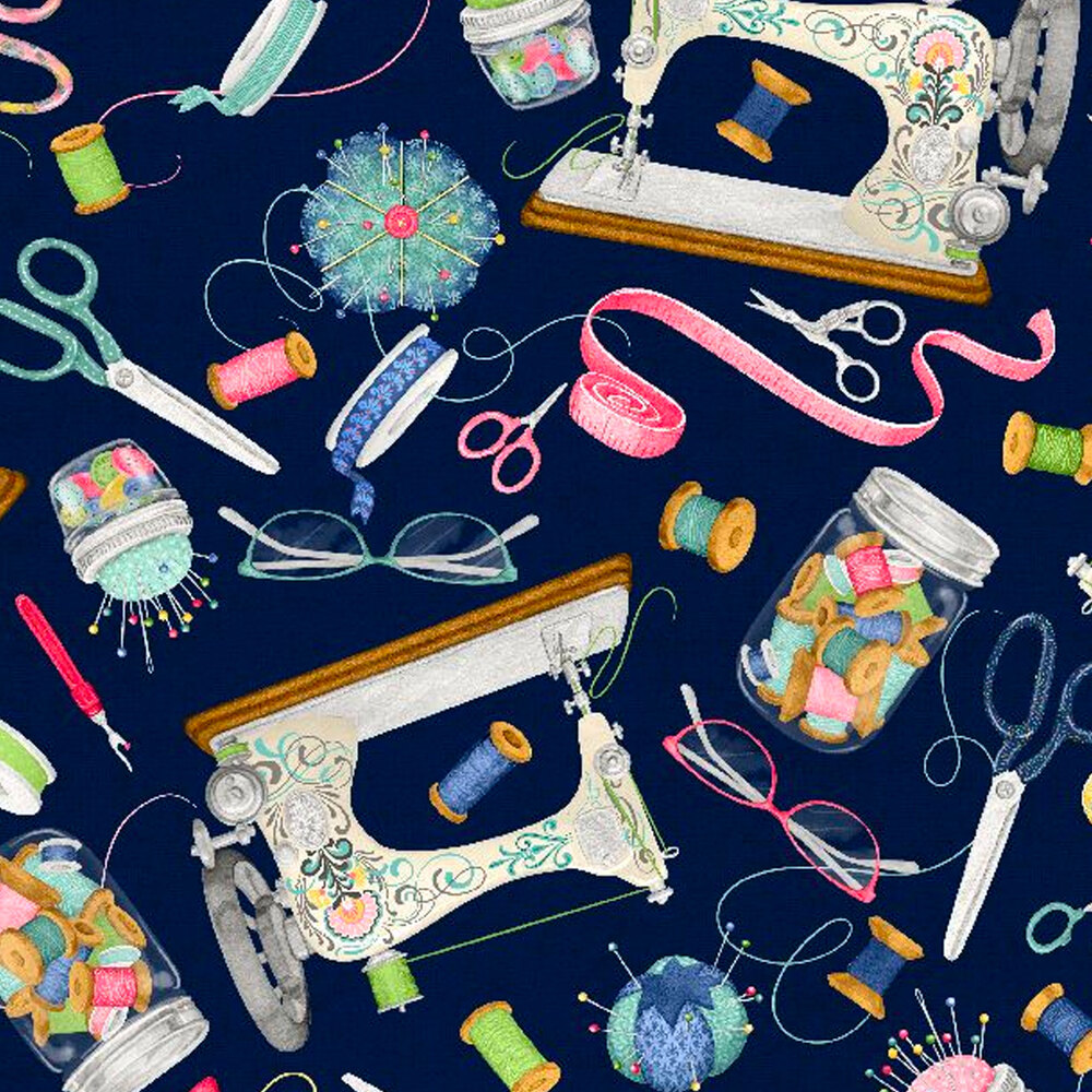 Sewing supplies tossed all over a blue background