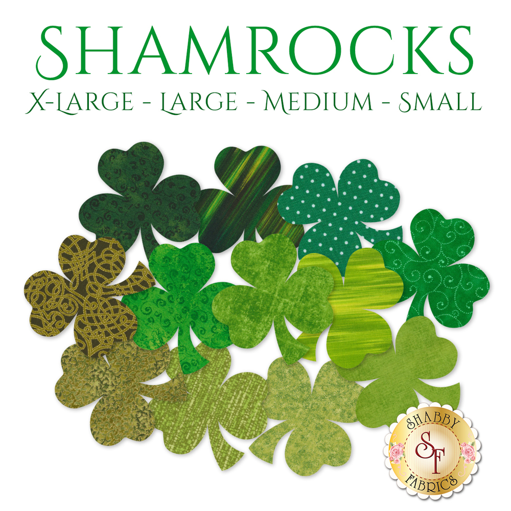 12 shamrock applique shapes in a variety of green and dark green print fabrics.