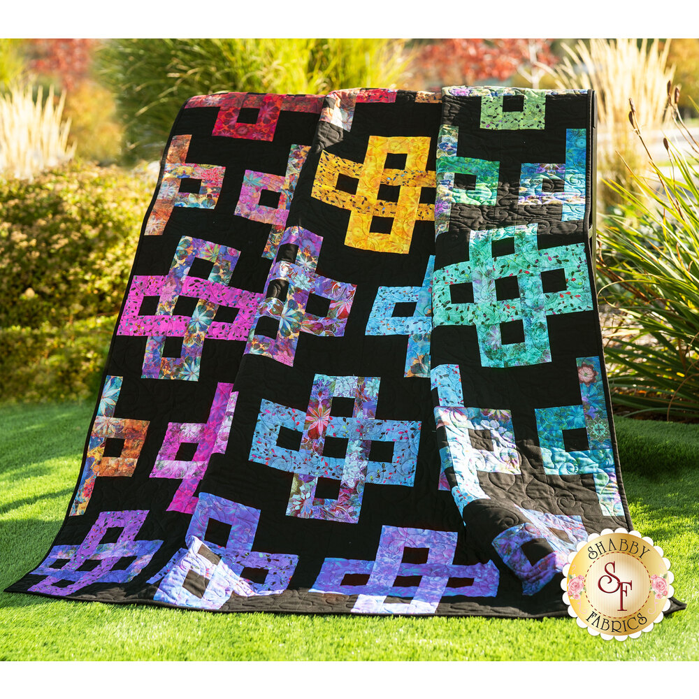 The beautiful Simplify Quilt Kit made with Venice Batik fabrics displayed out in the sun