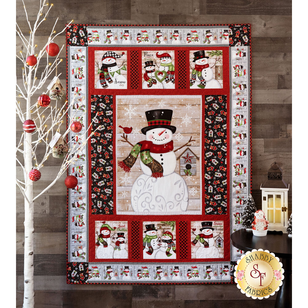 Snow Place Like Home Panel Quilt hung on a wall