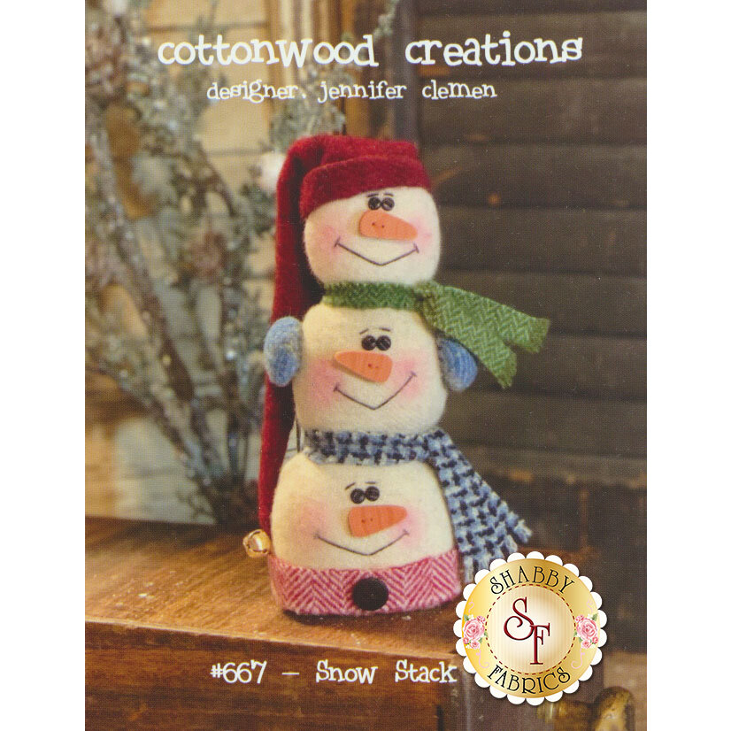 The front of the Snow Stack pattern showing the finished snowman stacker   Shabby Fabrics