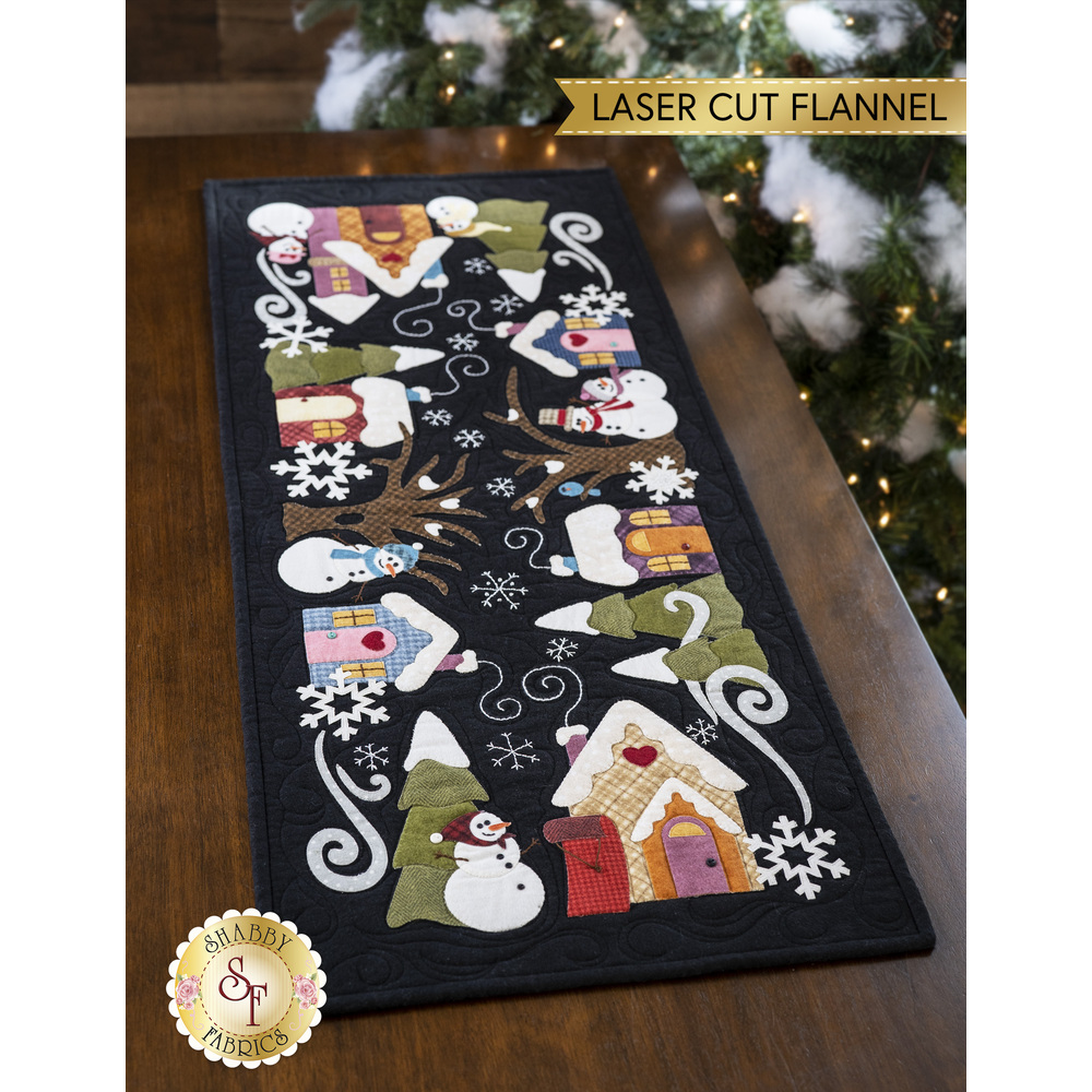 The adorable Snowman Lane Flannel Table Runner displayed on a table | Shabby Fabrics
