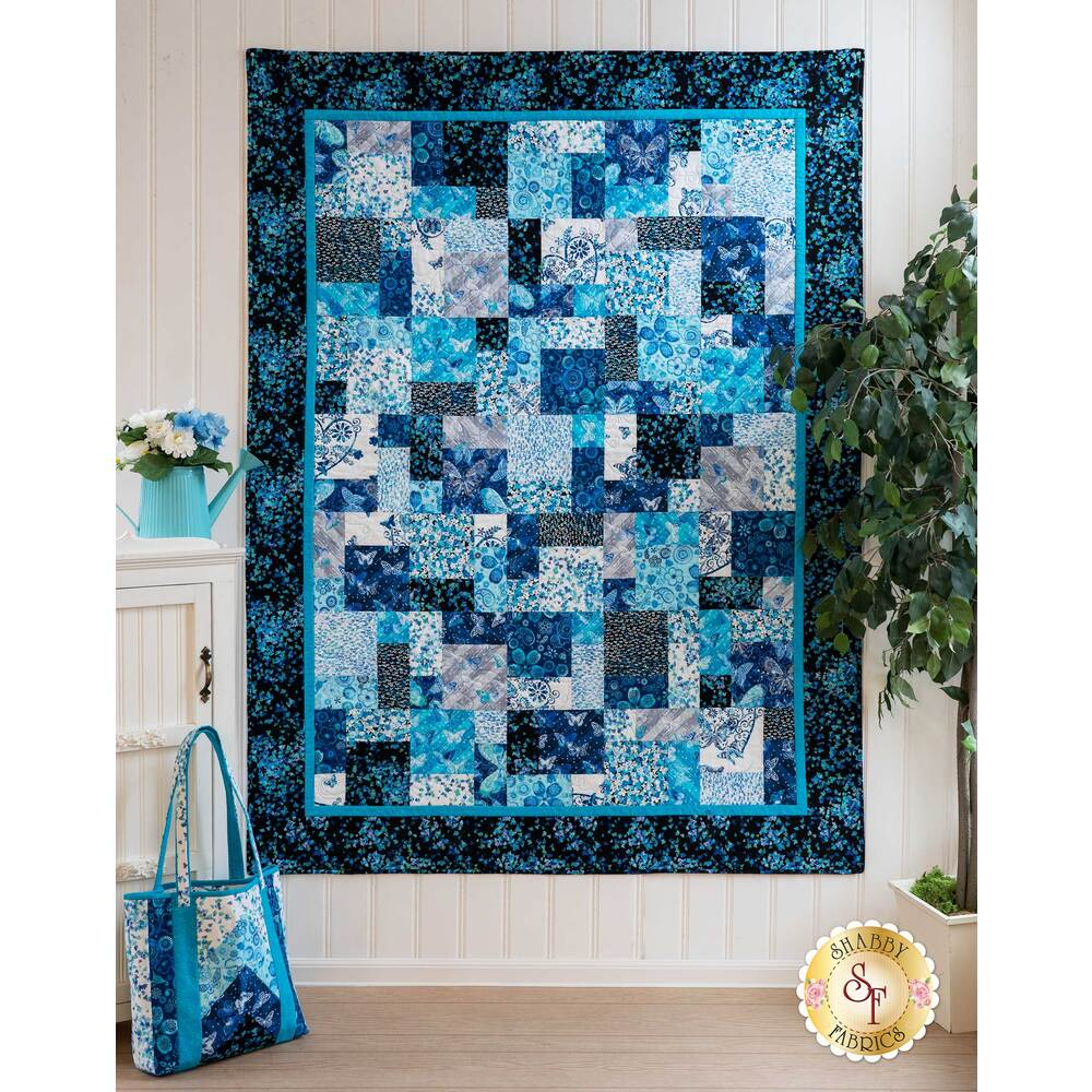The beautiful Easy As ABC - Social Butterfly Quilt displayed on a wall