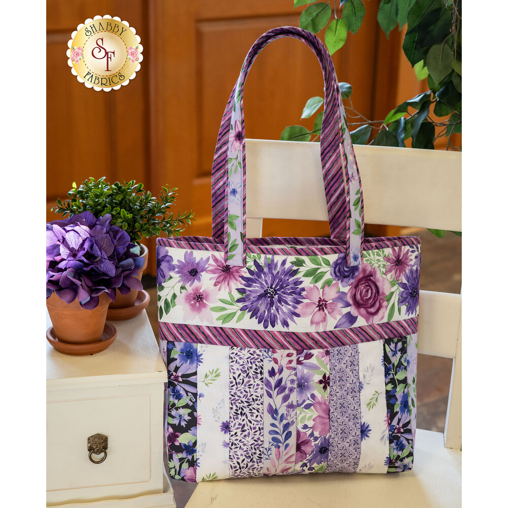 The beautiful Amethyst Magic Sophie Tote displayed on a cute wooden chair | Shabby Fabrics