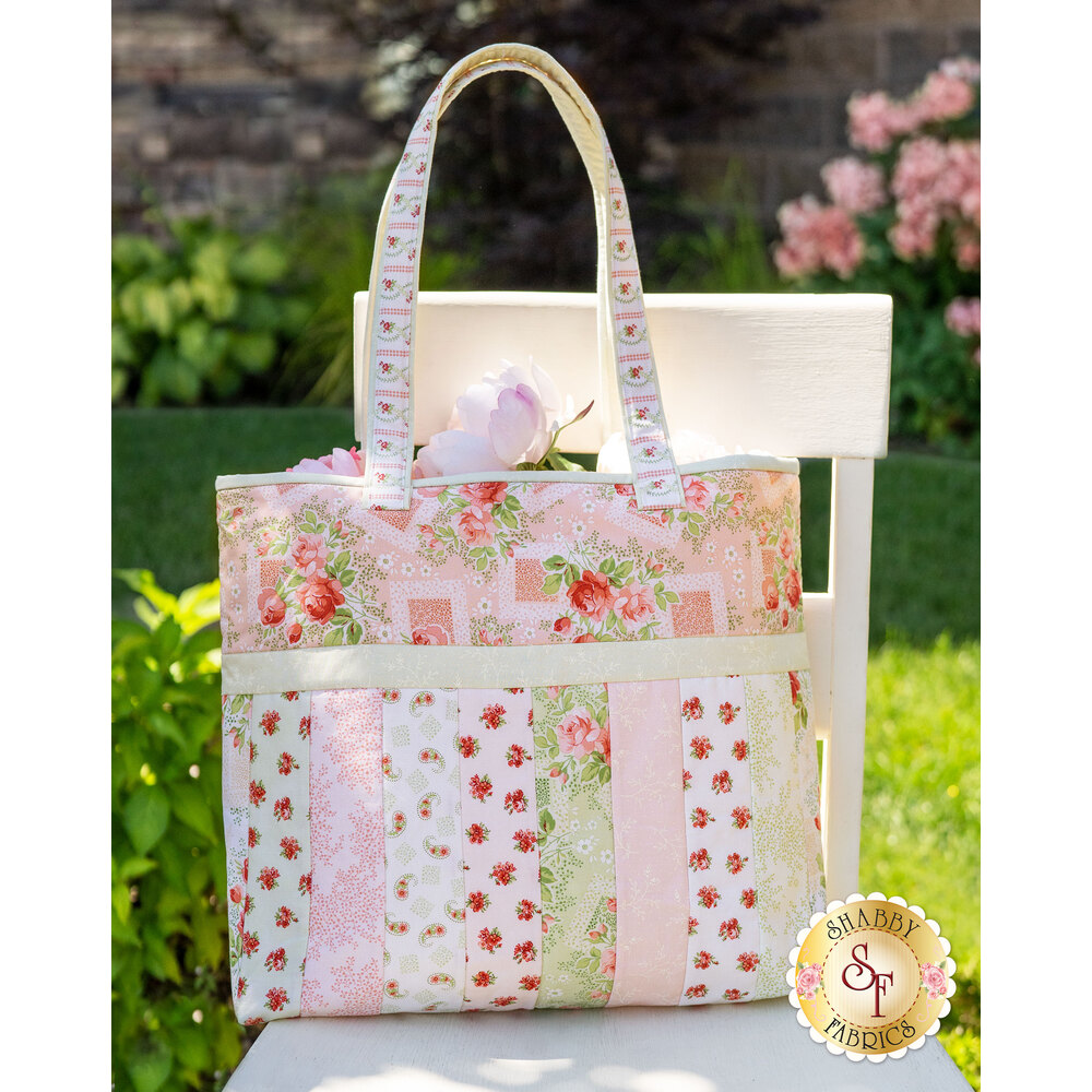 The Violet's Garden Sophie Tote displayed outside on a chair | Shabby Fabrics