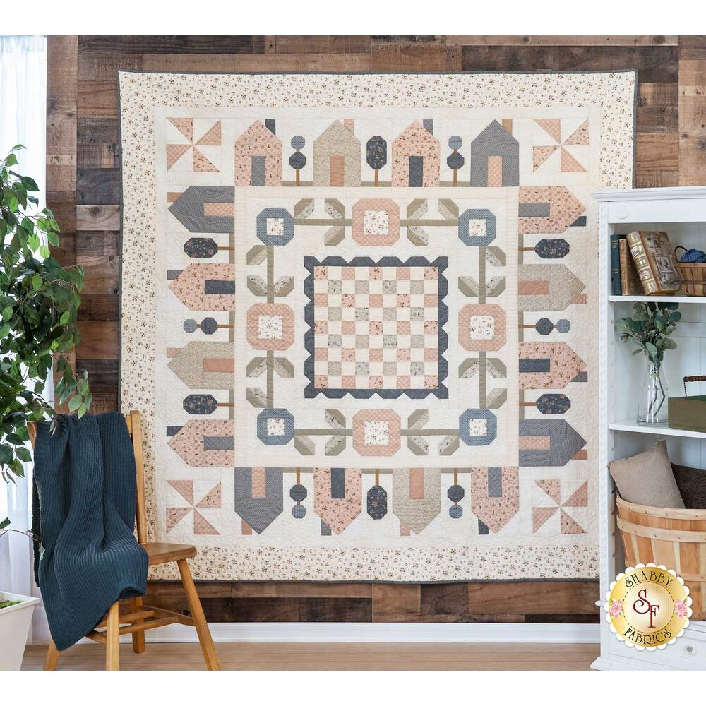 The beautiful Springville quilt hanging on a wall | Shabby Fabrics