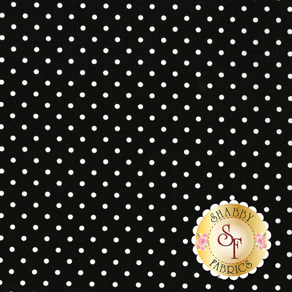 A classic polka dot print with white polka dots on a black background | Shabby Fabrics