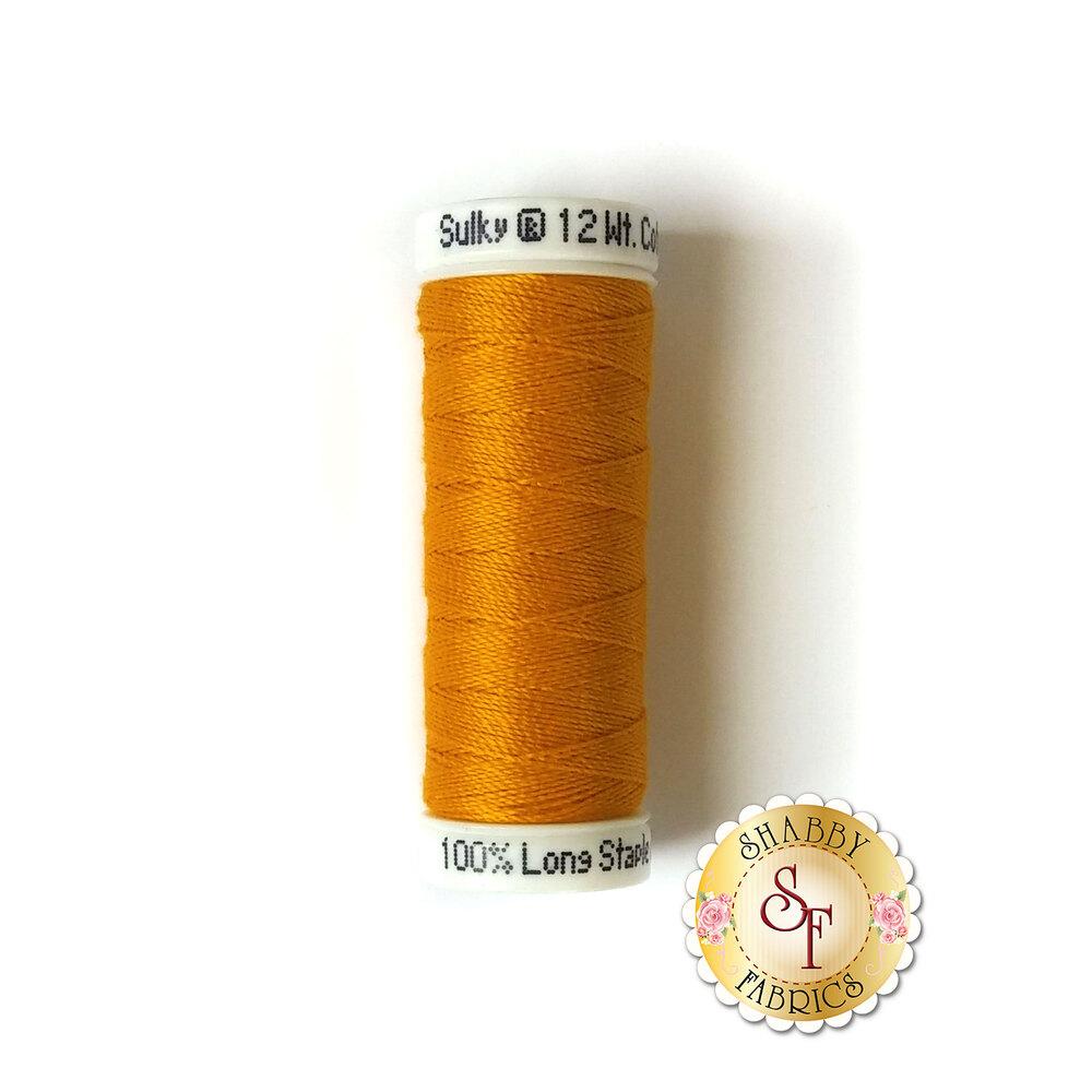 A spool of beautiful orange thread - Sulky Cotton Petite #1238