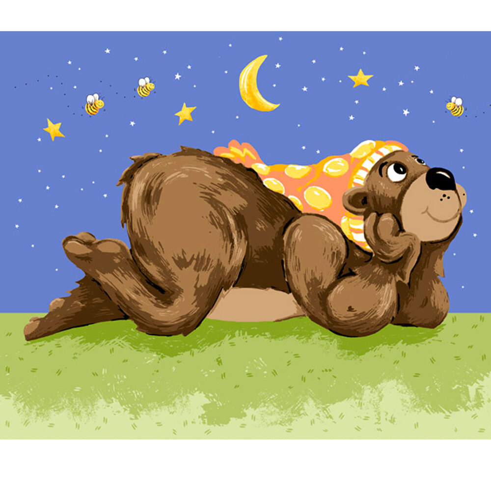Baron the bear laying in the grass looking up at bees in the moonlight