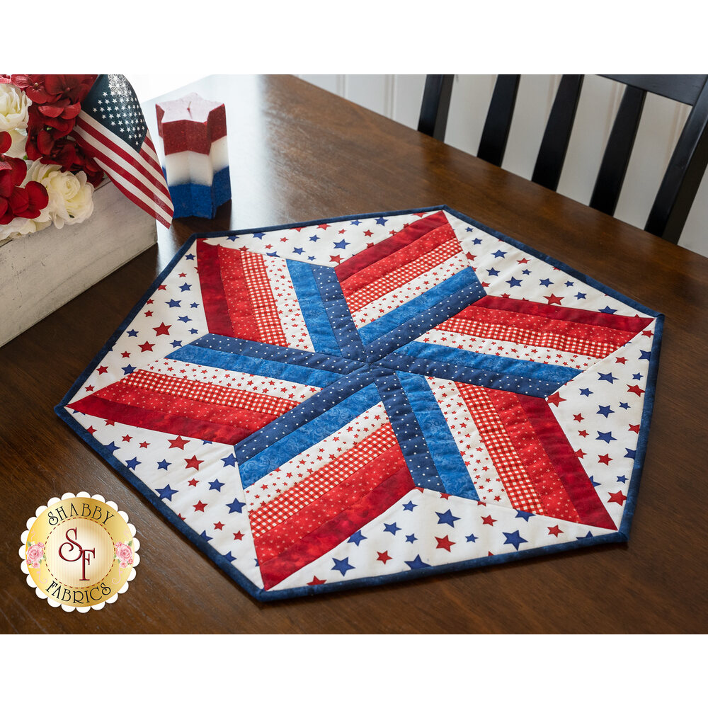 A patriotic red white and blue table topper displayed on a wooden table