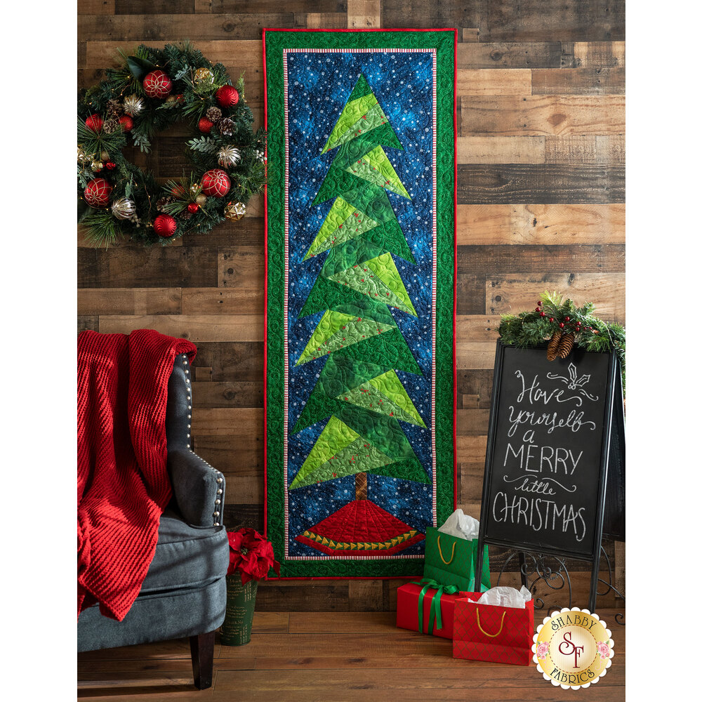 The Tall Trim the Tree wall hanging displayed on a wall | Shabby Fabrics