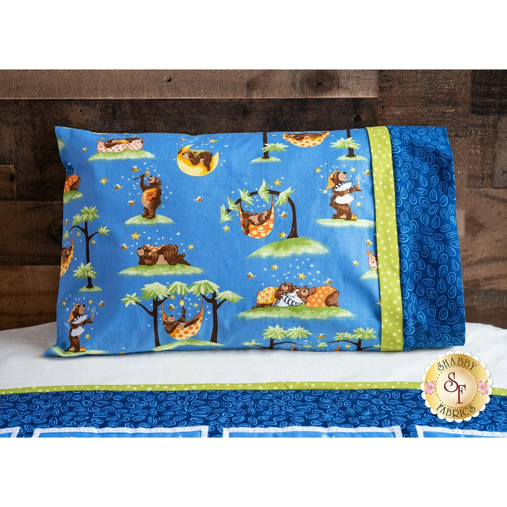The adorable Barron the Bear Travel Pillowcase displayed on a bed | Shabby Fabrics