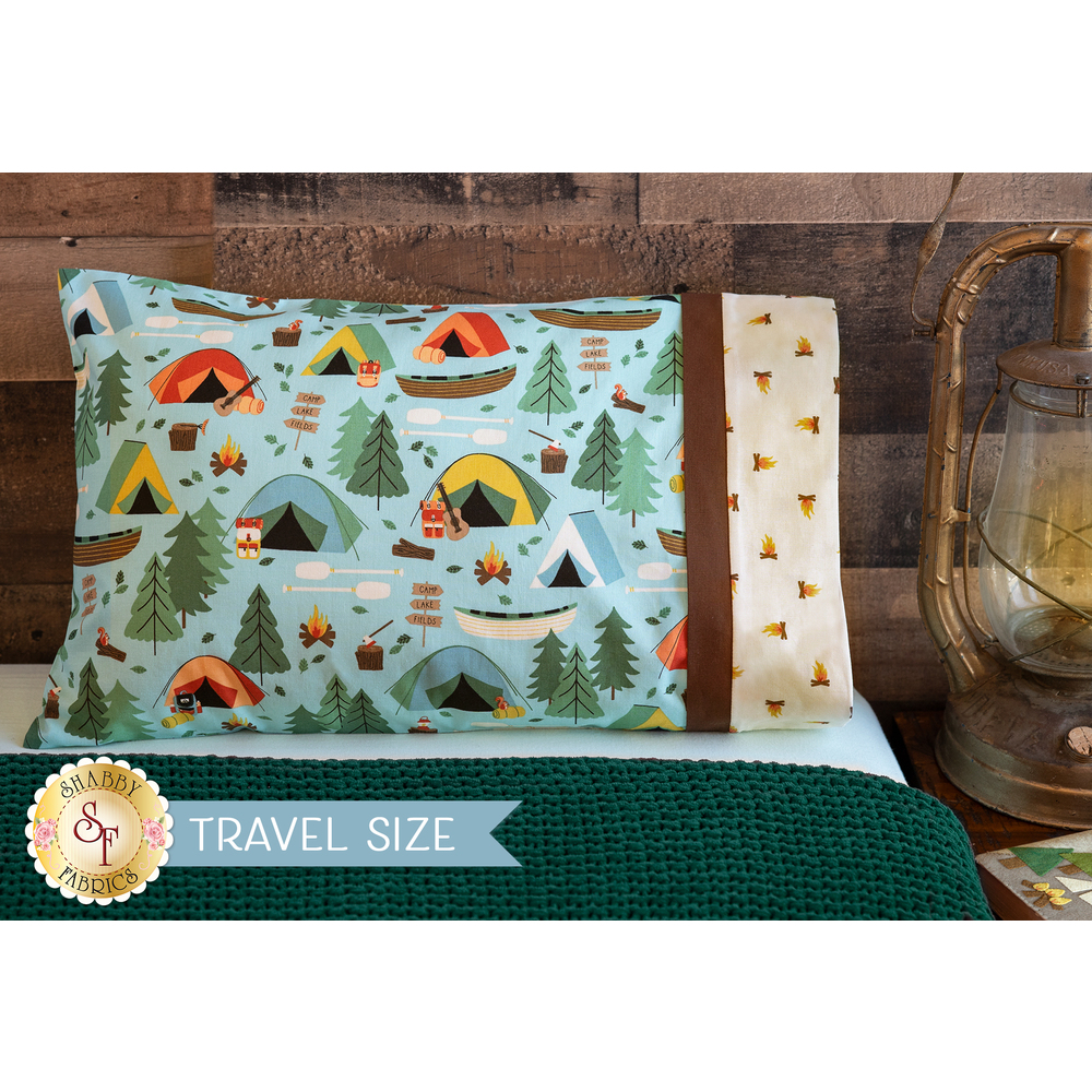 The Magic Pillowcase - Camping Crew in blue displayed on a bed | Shabby Fabrics