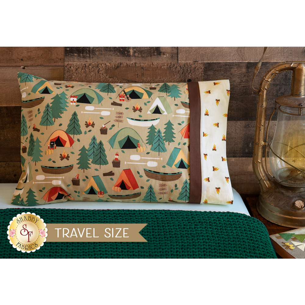 The Magic Pillowcase - Camping Crew in tan displayed on a bed | Shabby Fabrics
