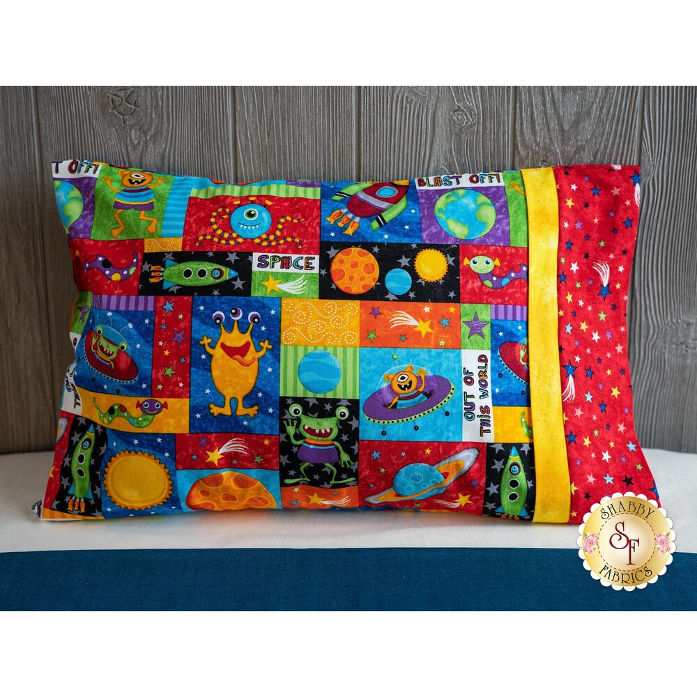 The adorable Lost in Space Travel Pillowcase displayed on a bed | Shabby Fabrics