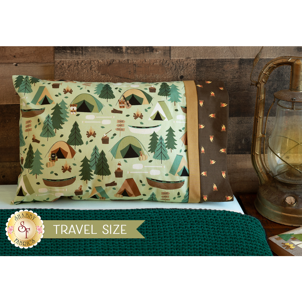The darling Magic Pillowcase - Camping Crew in green displayed on a bed | Shabby Fabrics