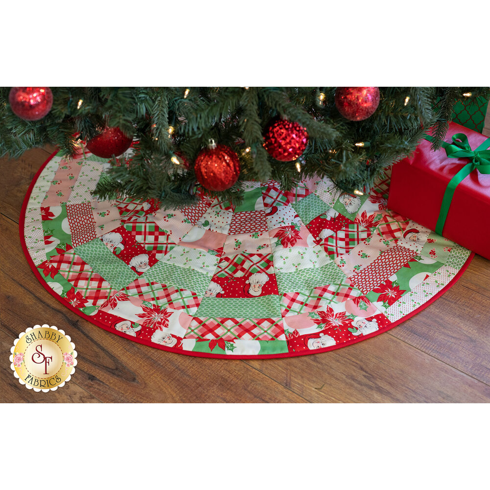 A retro tree skirt featuring the Swell Christmas fabrics under a Christmas tree