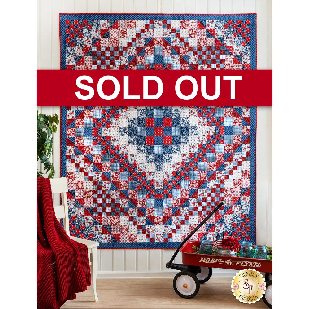 The beautiful Trip Around the World Quilt displayed hanging on a wall | Shabby Fabrics