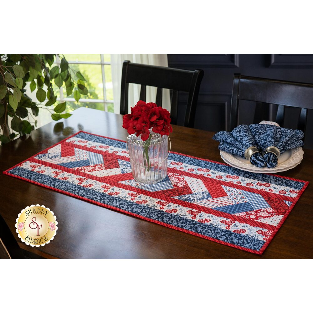 The patriotic Quilt As You Go Venice Table Runner - Summertime displayed on a table | Shabby Fabrics