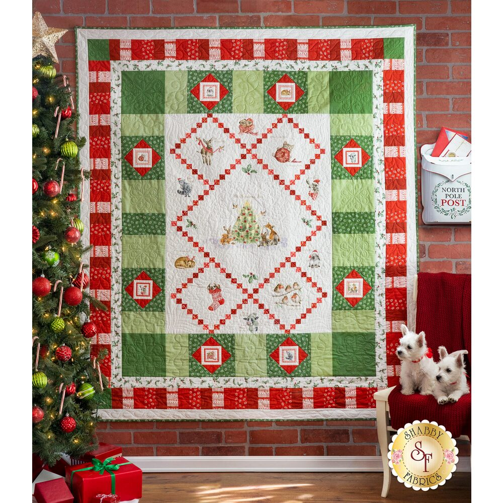 The adorable Warm Wishes quilt hung on a wall | Shabby Fabrics