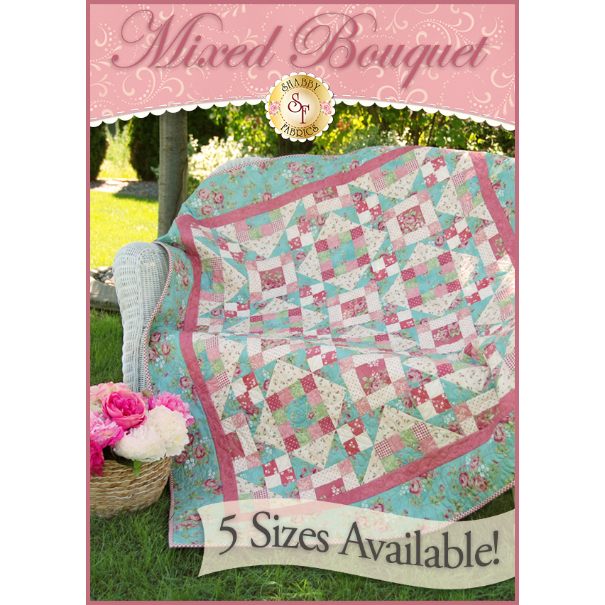 Turquoise and pink patchwork quilt from squares and half-square triangles.