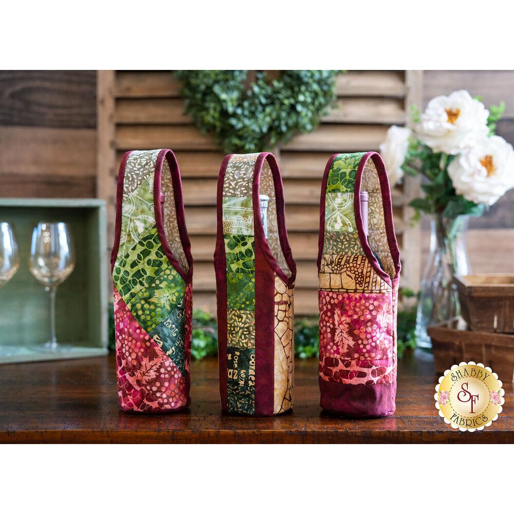 Three beautiful wine totes made with the Vino Batiks fabrics | Shabby Fabrics