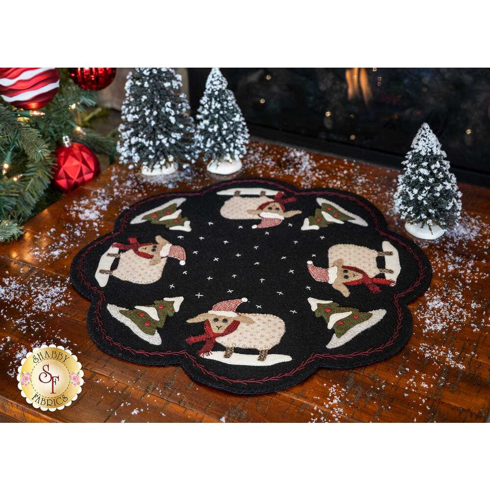Black wool mat featuring adorable sheep and Christmas trees | Shabby Fabrics