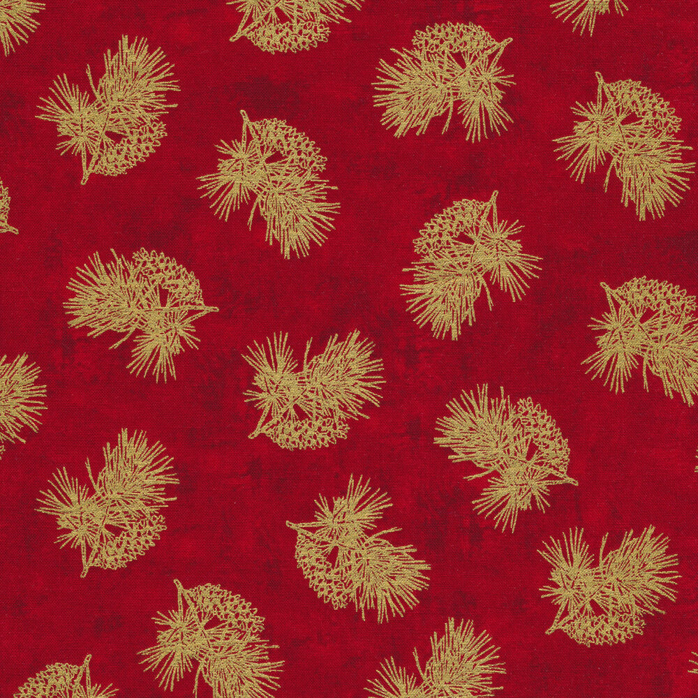 Tossed metallic evergreen and pine cones on a red background