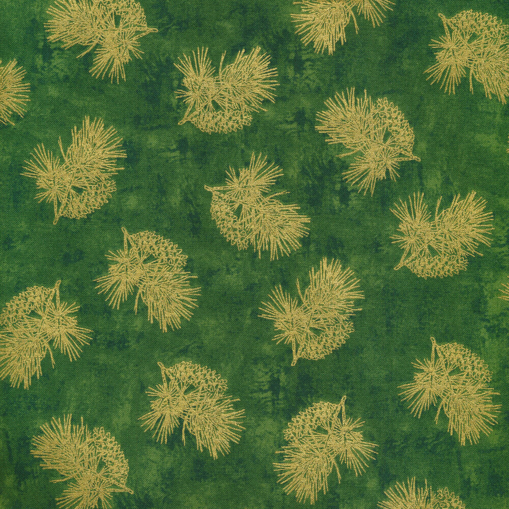 Tossed metallic evergreen and pine cones on a green background